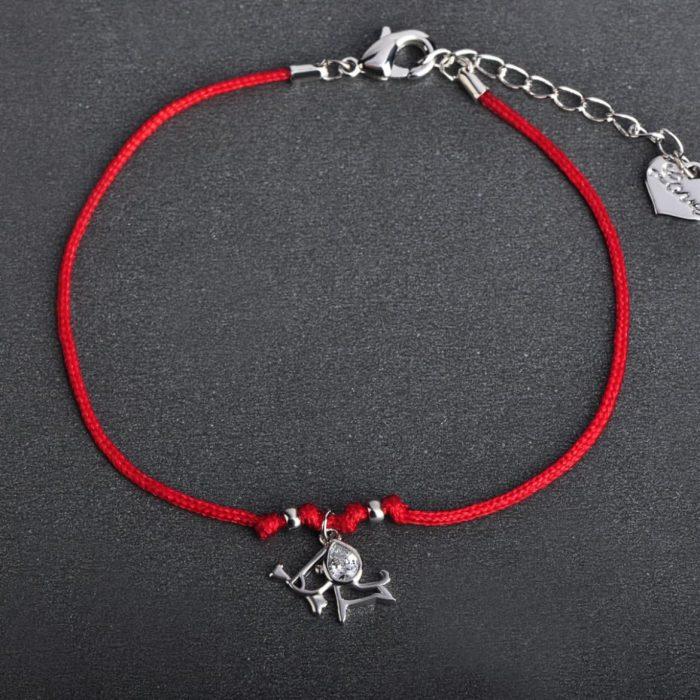 Женский браслет красная нить с собачкой